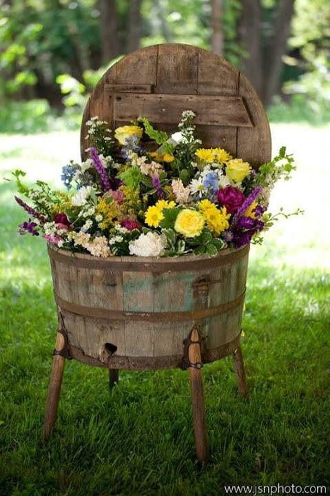 flower beds in barrels